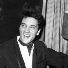Singer Elvis Presley smiles during a press conference inside his private railroad car at Los Angeles Union Station, California, United States as he arrived on April 20, 1960 to make a movie. (AP Photo/HPM)