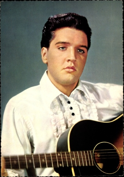Singer and Actor Elvis Presley with guitar