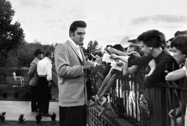 Tuesday, November 27, 1956, at Audubon Drive with fans