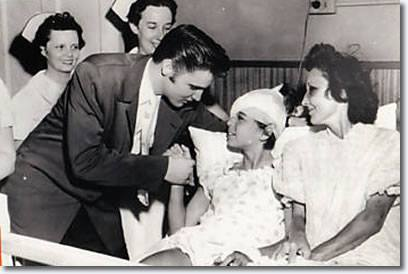 July 5 , 1956 Elvis visiting 12 year old Ellen Mincey at St. Joseph's Hospital in Memphis
