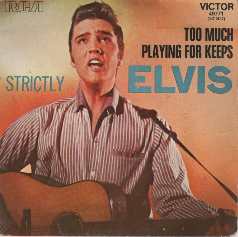 1957 ELVIS PRESLEY's single Too Much hits #1