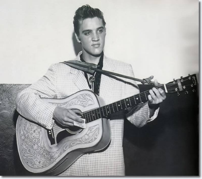 Elvis young with the guitar